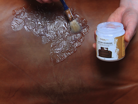 Removing grease from leather - applying Leather Degreaser