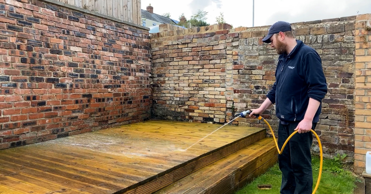 Decking being cleaned