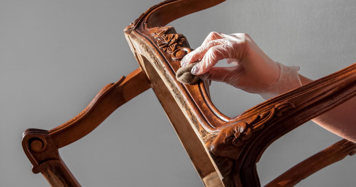 Waxing wood furniture with a beeswax polish