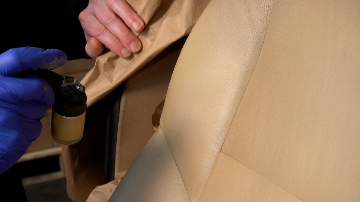 Spraying colour onto a leather car seat